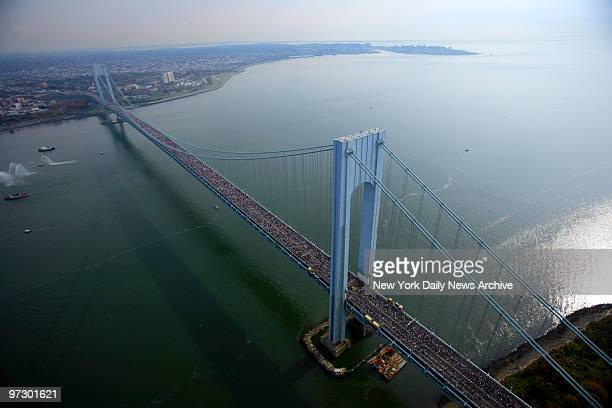 Thousands of runners make their way over the VerrazanoNarrows Bridge from Staten Island to Brooklyn during the start of the 2006 ING New York City...