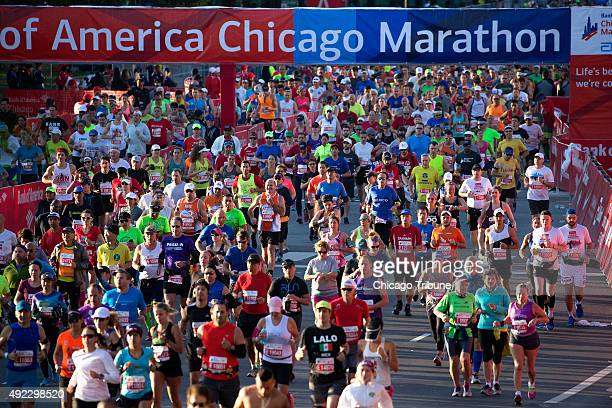 Thousands of runners take off from Monroe Street and head up Columbus Drive for the start of the Bank of America Chicago Marathon on Sunday Oct 11...