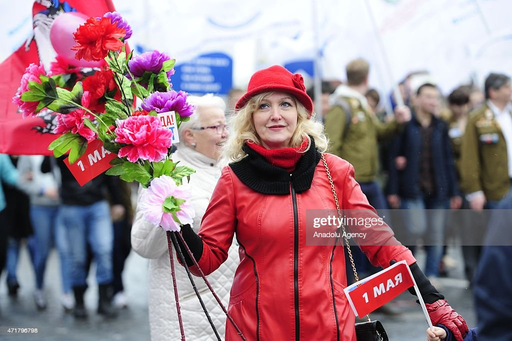 Thousands of Russian people take part in a rally to mark May Day International Workers' Day in Moscow's Red Square Russia on May 1 2015 Laborers...