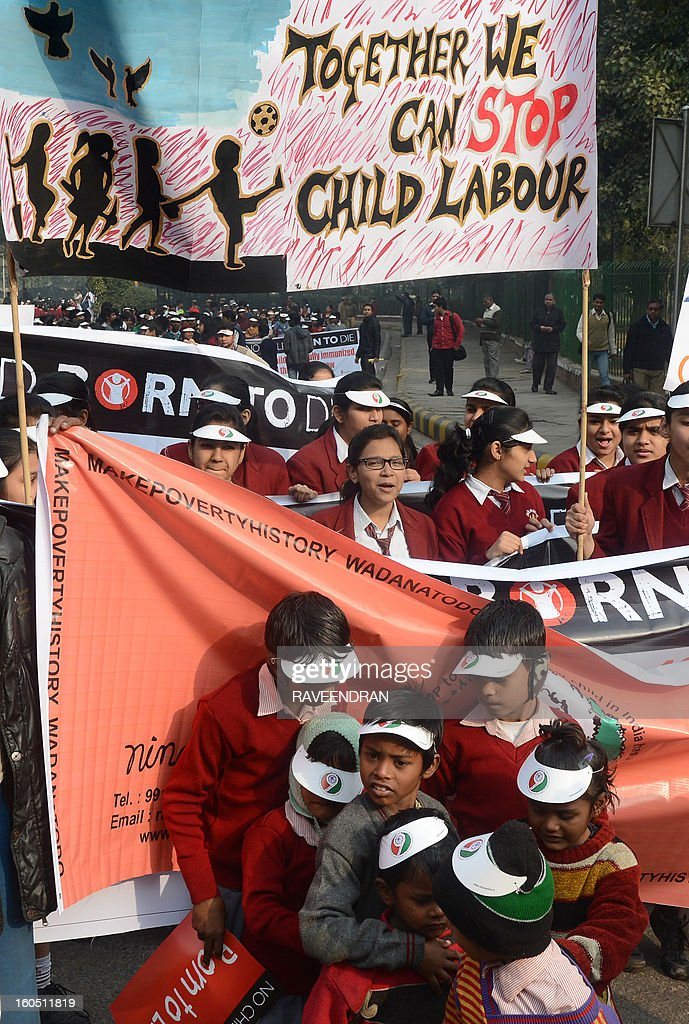 Thousands of school children hold placards and banners as they march during the 'Nine is Mine', Public Day March in New Delhi on February 2, 2013. 'Nine is Mine' is a participatory children's initiative to ensure that the Central Government commits nine percent of the GDP on Health and Education as promised by the Congress-led UPA Government in their National Common Minimum Programme.