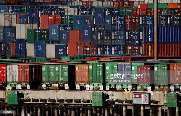 Thousands of shipping containers are stacked near the Vincent Thomas Bridge at the Port of Los Angeles March 14 2002 in Los Angeles CA where a danger...