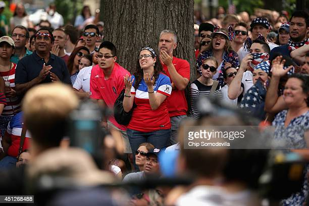 Thousands of soccer fans gather in Dupont Circle park to watch the US v Germany World Cup match June 26 2014 in Washington United States The German...