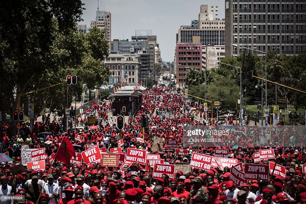 Thousands of South African opposition Economic Freedom Fighter (EFF) supporters march towards the constitutional court where judges heard a case over public money spent on President Jacob Zuma's private house on February 9, 2016 in Johannesburg. / AFP / JOHN WESSELS