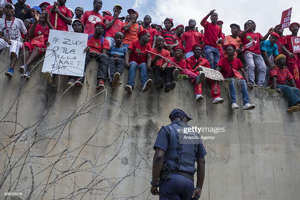 Thousands of South African opposition Economic Freedom Fighters (EFF) supporters demonstrate near the constitutional court during a hearing of the case over the allegations that President Jacob Zuma unduly benefited from public funds during security upgrades to country home, on February 9, 2016 in Johannesburg, South Africa.