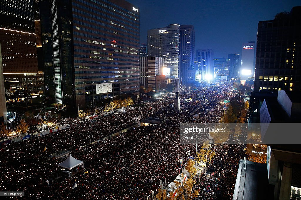 Thousands of South Koreans take to the streets in the city center to demand President Park Geun-Hye to step down on November 12, 2016 in Seoul, South Korea. Approximately hundreds of thousands of people joined the anti-government protest Saturday amid rising public frustration for President Park Geun-hye's corruption scandal.