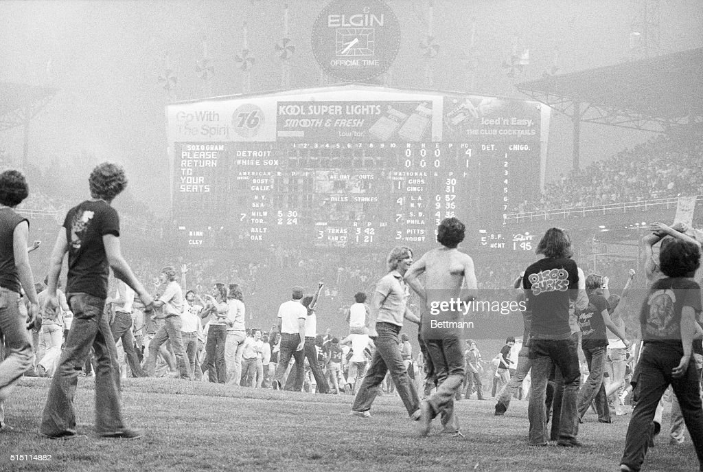 Thousands of spectators pour onto the playing field here at Comiskey Park during an 'AntiDisco' demonstration The situation developed after a...
