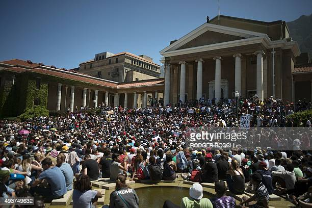 Thousands of students converge at the University of Cape Town on October 22 in Cape Town for a meeting about ongoing protests against fee hikes by...