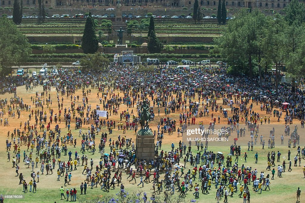 Thousands of students march down the streets towards the seat of government on October 23 2015 in Pretoria to hold a demonstration against university...