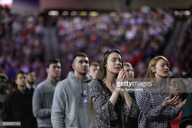 Thousands of students supporters and invited guests sing songs of Christian praise before Republican presidential candidate Donald Trump delivers the...