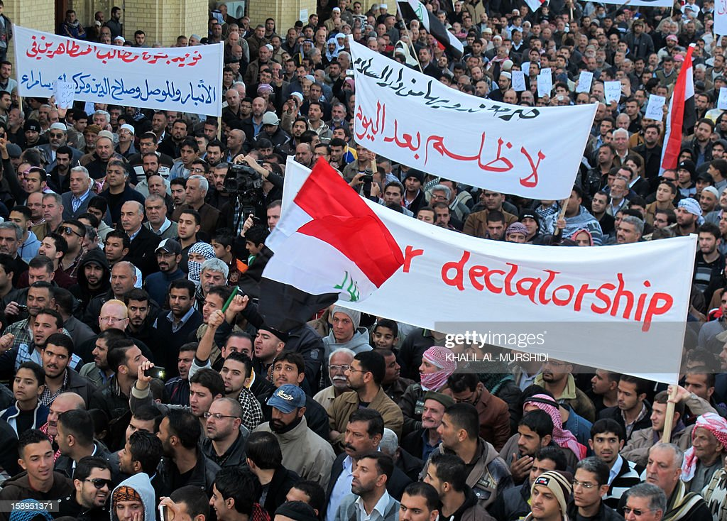Thousands of Sunni Muslim protestors hold banners and shout slogans during a demonstration on January 4, 2013 criticising Iraq's premier and demanding the release of prisoners they say are wronglfully held, near Abu Hanifa mosque, in the mostly Sunni Muslim neighbourhood of Aldhamiya in Baghdad. The protesters held up banners calling for a mass prisoner release, stronger human rights provisions in Iraq's prisons, and a repeal of current anti-terror legislation.