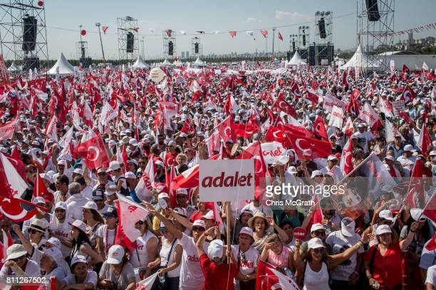 Thousands of supporters cheer and wave flags while waiting for the start of the 'Justice Rally' held by Turkey's main opposition Republican People's...