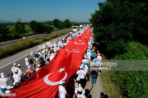 Thousands of supporters hold a 1 100 meterslong national flag as they follow Kemal Kilicdaroglu the leader of Turkey's main opposition Republican...