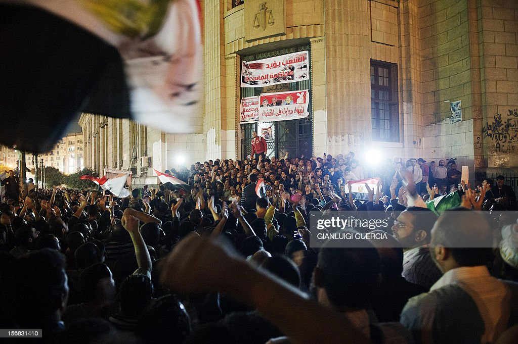 Thousands of supporters of Egyptian President Mohammed Morsi celebrate in front of the Egyptian high court in Cairo on November 22, 2012, after Morsi assumed sweeping powers, putting him on a collision course with the judiciary and raising questions about the country's democratic future. The move, just a day after Morsi took diplomatic centre stage in brokering a ceasefire between Israel and Gaza's Islamist Hamas rulers, earnt him the same derisive monicker of 'new phararoh' levelled at veteran strongman Hosni Mubarak before his ouster in a popular uprising last year. AFP PHOTO/GIANLUIGI GUERCIA