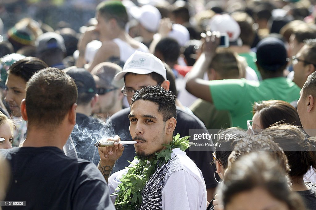 Thousands of supporters of legalized marijuana light up at exactly 420 pm in Civic Center Park April 20 2012 in Denver Colorado Colorado goes to the...