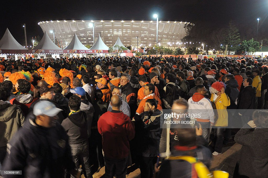 Thousands of supporters wait to enter Cape Town Stadium to watch the 2010 Football World Cup Semifinal between the Netherlands and Uruguay on July 6...