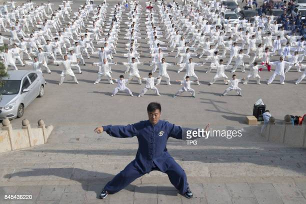 Thousands of Taiji boxing fans practice Taiji boxing in the Twin Towers Temple in Taiyuan City north Chinas Shanxi Province Sept9 2017 Ten million...