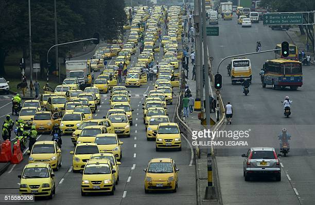 Thousands of taxi drivers gather in Bogota on March 14 2016 to protest against the Uber taxibooking mobile app leading to traffic congestion across...