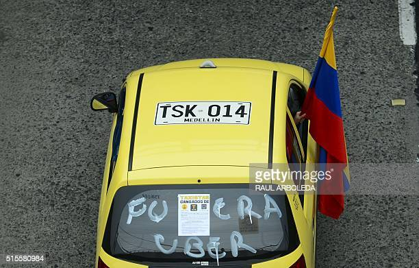 Thousands of taxi drivers gather in Medellin Colombia on March 14 2016 to protest against the Uber taxibooking mobile app leading to traffic...