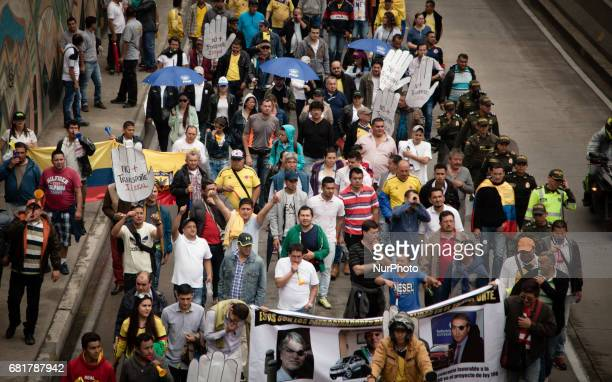 Thousands of taxi drivers shouting slogans against Ubert such as Uber out and Down with piracy brought traffic to a near standstill in Bogota the...