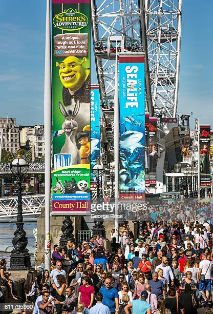 Thousands of tourist jam The Queen's Walk near the London Eye and adjacent to County Hall on September 11 in London England The collapse of Great...