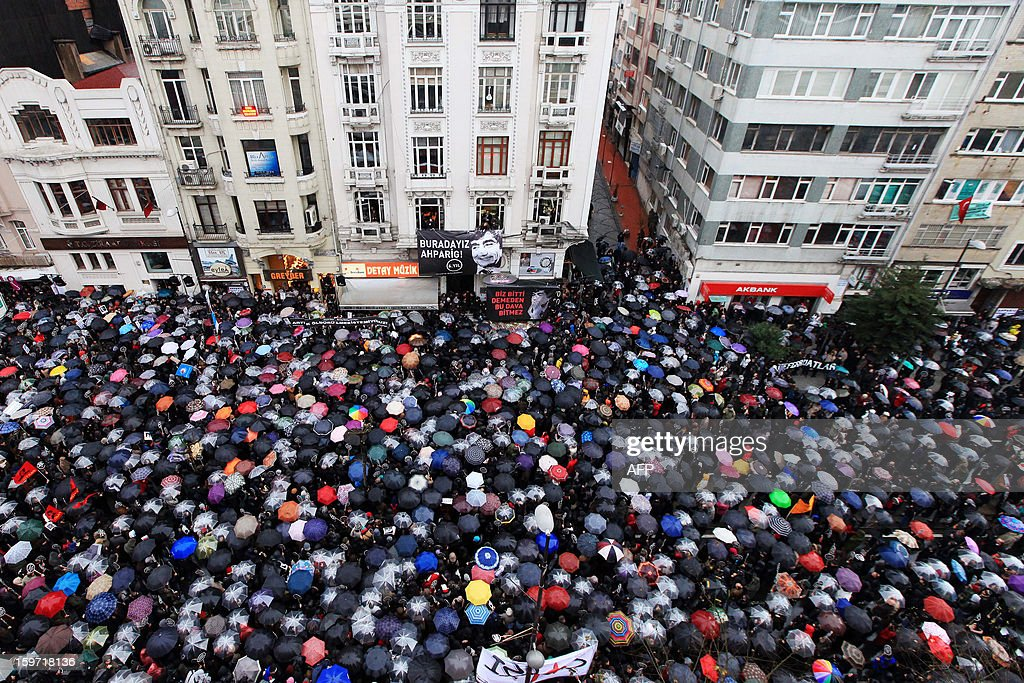 Thousands of Turkish people gather in front of the offices of Armenian newspaper 'Agos' during a commemoration ceremony for slain journalist Hrant Dink ,in Istanbul, on January 19, 2013. Dink, one of the most prominent voices of Turkey's shrinking Armenian community, was killed by a gunman on January 19, 2007. The 52-year-old Dink, a prominent member of Turkey's tiny Armenian community, campaigned for reconciliation but was hated by Turkish nationalists for calling the World War I massacres of Armenians a genocide.