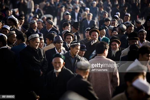 Thousands of Uighur muslim men gather at the central mosque in Kashgar for a call to prayer marking the end of Ramadan fasting on October 13 2007 in...