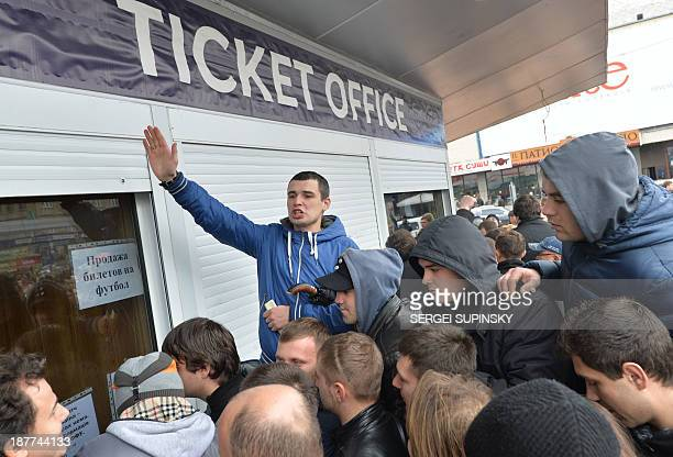 Thousands of Ukrainian football fans queue in front of Kiev Olympic stadium's ticket office on November 12 to buy tickets for the World Cup 2014...