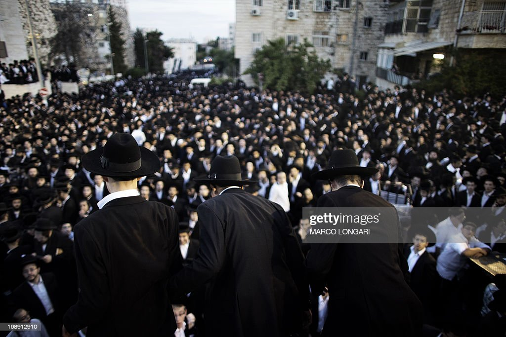 Thousands of Ultra Orthodox Jews gathered in front of the main army recruitment office in Jerusalem on May 16, 2013 to demonstrate against any plans to make them undergo military service, a police spokesman said. Protesters also prayed and chanted 'the Torah above everything!' referring to Jewish religious law, and 'the army will not take yeshiva (religious seminary) pupils.' AFP PHOTO / MARCO LONGARI