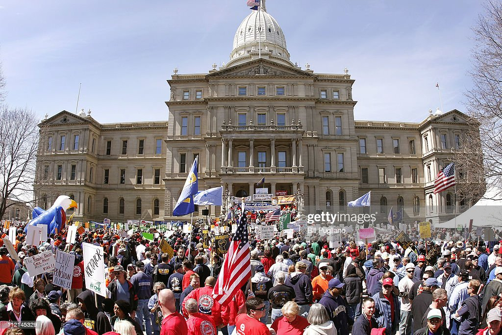 Thousands of union members from around the state gather at the State Capitol to protest Michigan Republican Gov Rick Snyder's proposed budget cuts...