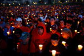 Thousands of Virginia Tech students take part in a mass candlelight vigil to honor the victims of yesterday's shootings April 17 2007 in Blacksburg...