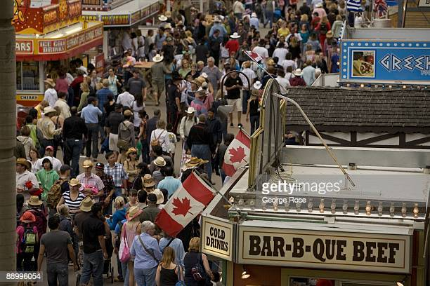 Thousands of visitors to the Calgary Stampede are seen walking through the food court in this 2009 Calgary Canada afternoon photo