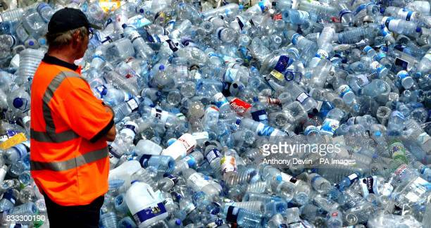 Thousands of water bottles that were needed after the water supply was cut off following heavy flooding are sorted for recycling at Accord Waste...