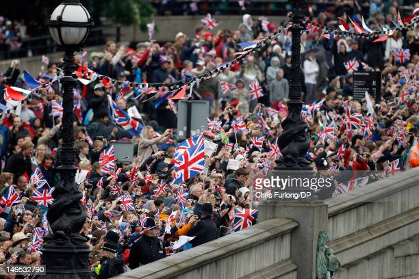 Thousands of wellwishers wave to the Queen on the royal barge 'The Spirit of Chartwell' during the Thames Diamond Jubilee River Pageant on June 3...