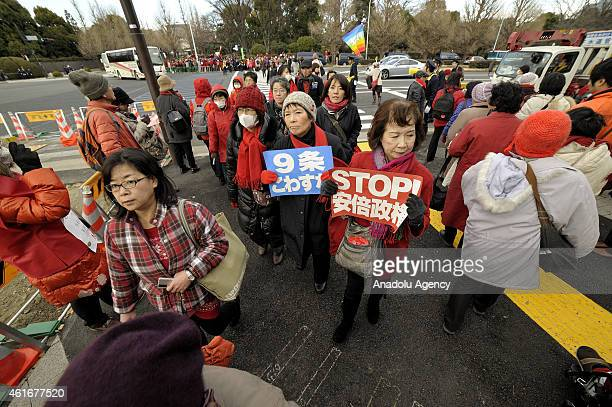 Thousands of women with red clothes gather in front of the Japanese parliament on January 17 2015 in Tokyo Japan A human chain takes up position...