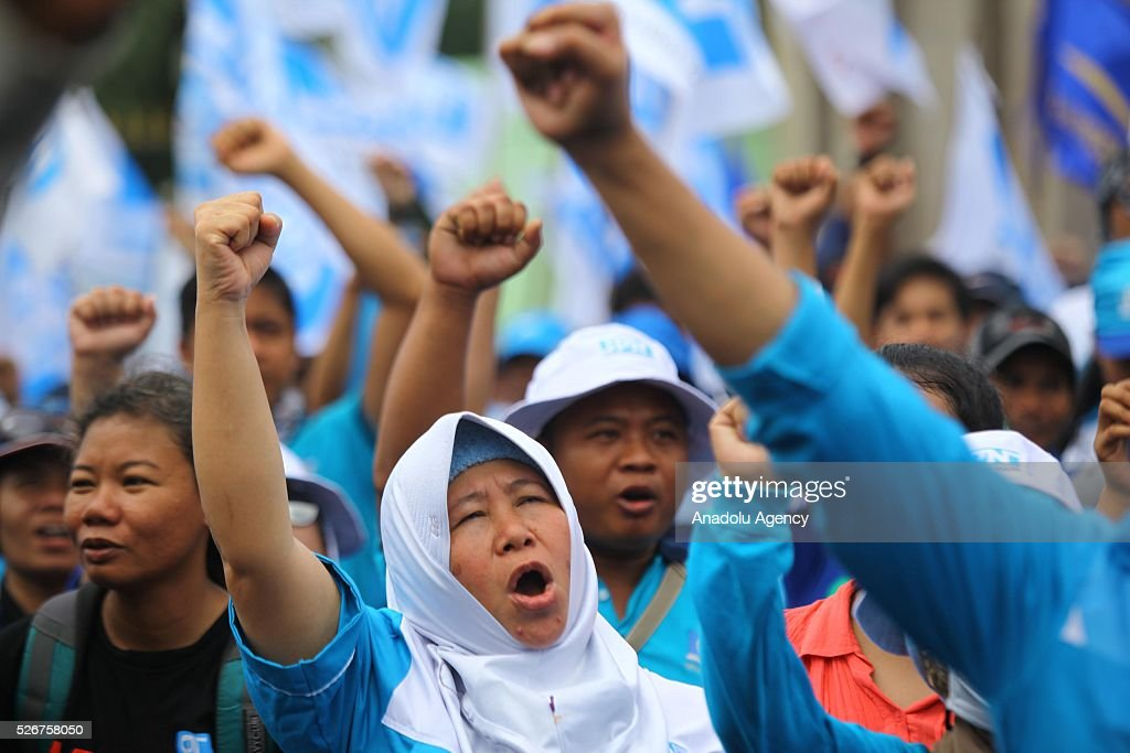 Thousands of workers and labor activists march down to Jakarta's central business district marking May Day, International Workers' Day on May 1, 2016 in Jakarta, Indonesia. Protesters across Indonesia have organized rallies to demand better working conditions.