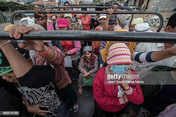 Thousands of workers every day cram together in trucks from the provinces to work in the many garment factories on May 4 2015 in Phnom Penh Cambodia...