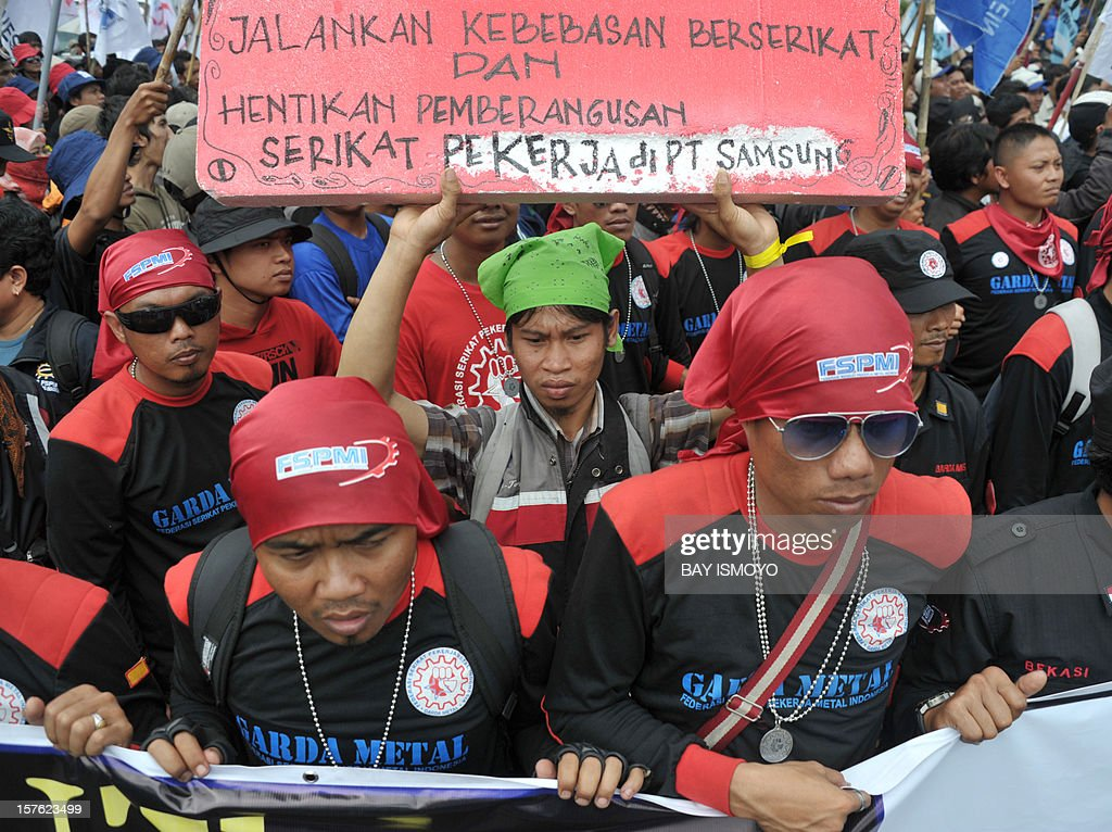 Thousands of workers from West Java march to foreign embassies, such as Japan and South Korea, in Jakarta on December 5, 2012 during a protest against the out sourching of work by multi-national companies. Indonesian workers are increasingly demanding higher wages and better conditions as Indonesia's economy grows, expanding 6.5 percent last year and forecast to stay above six percent for the next two years. AFP PHOTO / Bay ISMOYO