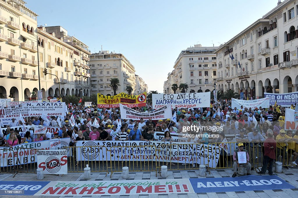 Thousands of workers holding placards and banners protest against austerity measures and the layoff of public workers on September 7 2013 in...