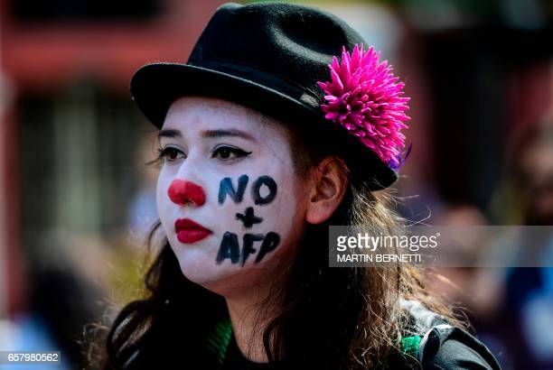 TOPSHOT Thousands of workers march to protest against the Pension Fund Administration in Santiago on March 26 2017 Demonstrations and marches were...