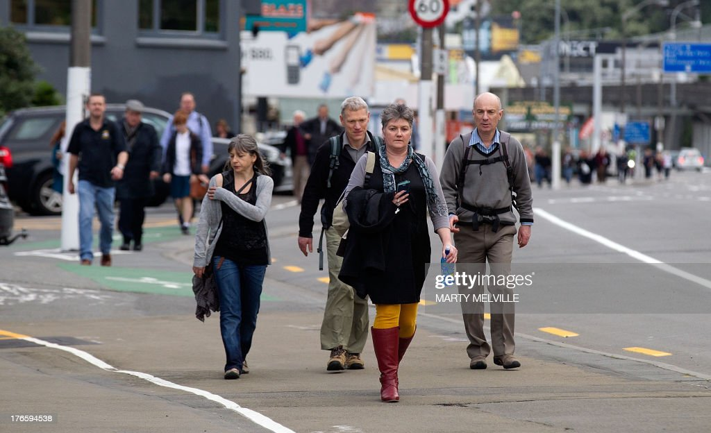 Thousands of workers walk home from the central business district of Wellington as the trains stop working after a 6.5 earthquake hit central New Zealand on August 16, 2013. The powerful earthquake rattled major cities across New Zealand, terrifying residents and causing the capital Wellington to shake 'like jelly', but authorities reported no major damage. Train services were stopped in case rails had buckled in the quake, but police said they had received no reports of significant injury or damage.