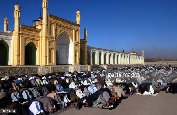 Thousands of worshippers attend special prayers in celebration of the first day of the Muslim Eid alFitr festival marking the end of the holy month...