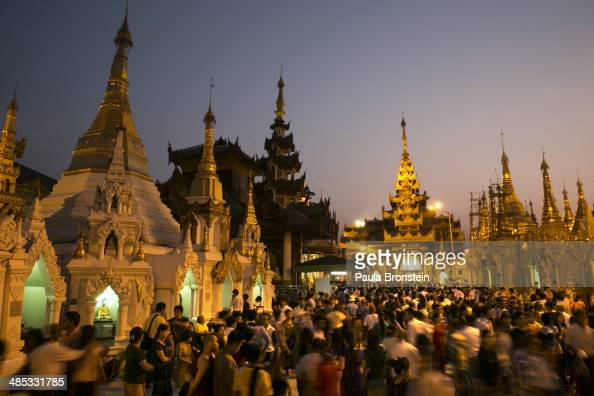Thousands of worshippers come to the Shwedagon pagoda to celebrate Thingyan a New Years Water festival April 17 2014 in Yangon Myanmar Thingyan is...