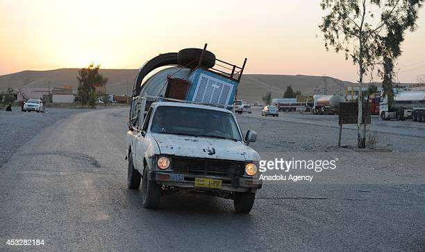 Thousands of Yazidi and Christian people flee Hamdaniyah town of Mosul to Erbil after the latest wave of ISIL advances that began on Sunday has seen...