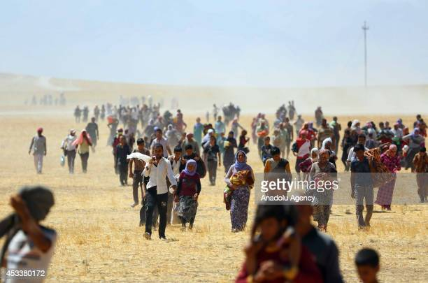 Thousands of Yezidis trapped in the Sinjar mountains as they tried to escape from Islamic State forces are rescued by Kurdish Peshmerga forces and...