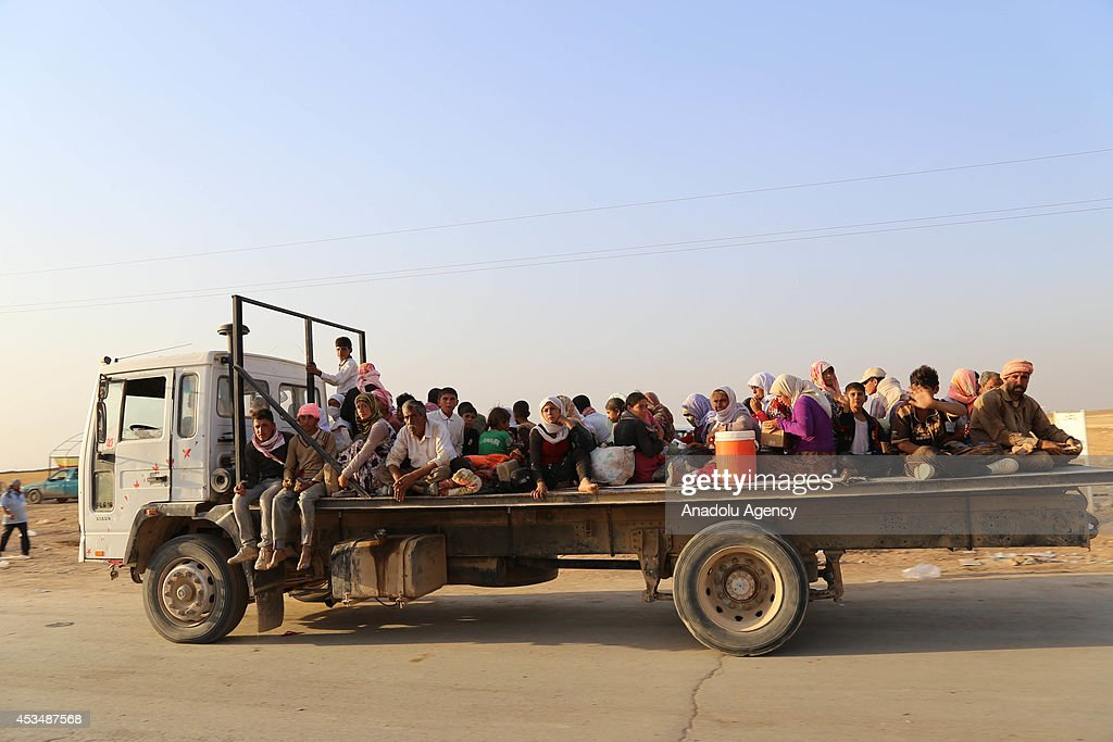 Thousands of Yezidis trapped in the Sinjar mountains without food and water for days, due to the Islamic State (IS) violence, formerly known as Islamic State of Iraq and the Levant (ISIL), arrive in Haseki city of Syria on August 10, 2014.