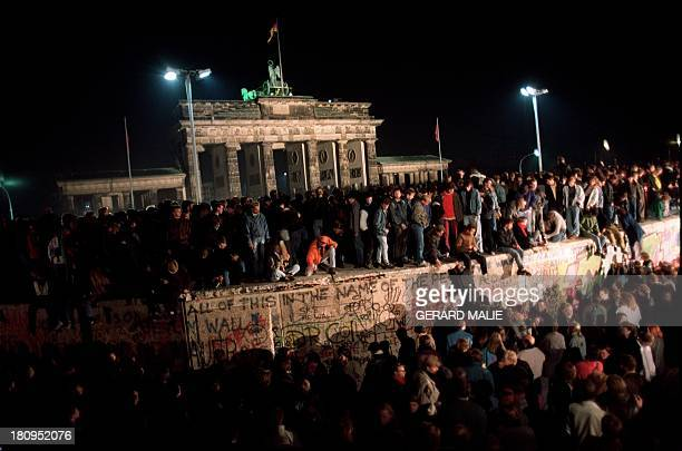 Thousands of young East Berliners crowd atop the Berlin Wall near the Brandenburg Gate 11 November 1989 Two days before Gunter Schabowski the East...