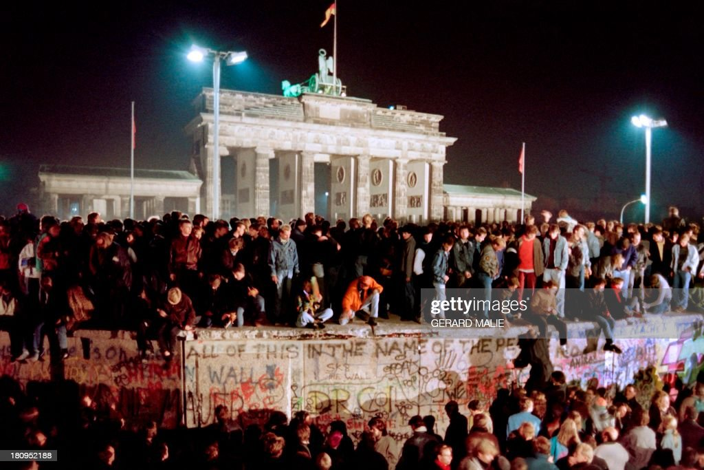 Thousands of young East Berliners crowd atop the Berlin Wall near the Brandenburg Gate on November 11 1989 Two days before Gunter Schabowski the East...