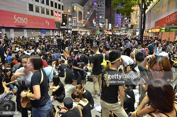 Thousands of young people wearing black Tshirts take part in the second night of a prodemocracy sitin known as 'Occupy Central' blocking traffic on...