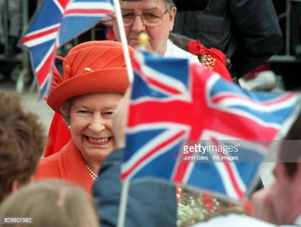 Thousands pack into Centenary Square Bradford to give a rousing reception for The Queen today Her Majesty was visiting the City to distribute Maundy...