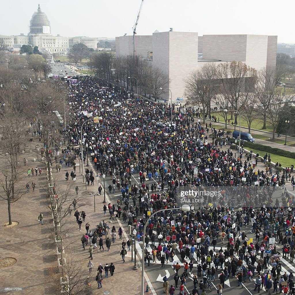 Thousands take part in the Justice for All March and Rally on Pennsylvania Avenue through downtown Washington DC December 13 to protest the killings...